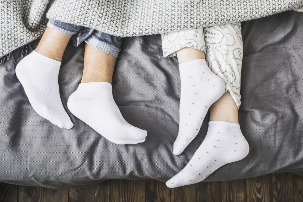 What to Know about Sleeping with Socks On